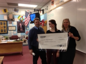 Nordstrom Scholarship winner Gwen Ranniger holds up her $10,000 check.