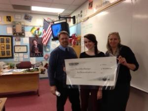 Nordstrom Scholarship winner Gwen Ranniger holds up her $10,000 check.