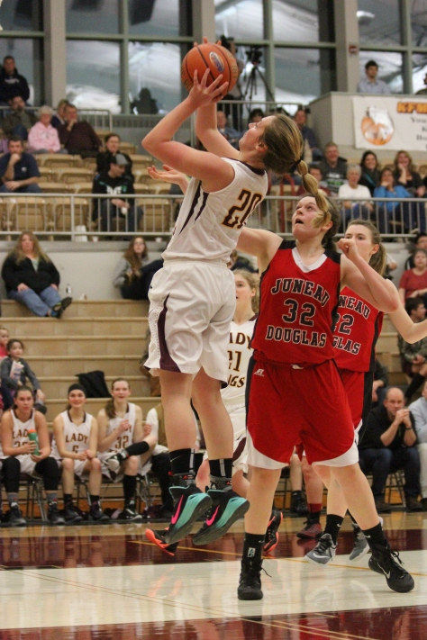 Lexi Biggerstaff scores two points in Kayhi's win over Juneau.