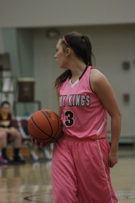 Senior Felicia Ruaro and the Lady Kings wore pink uniforms in Friday night's Pink Game to promote cancer awareness.