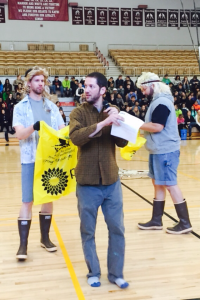 Mr. Sivertson gets some help from Mr. Lund and Mr. Pader in a skit about safety while picking up trash.